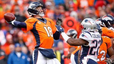 Peyton Manning of the Denver Broncos passes in
