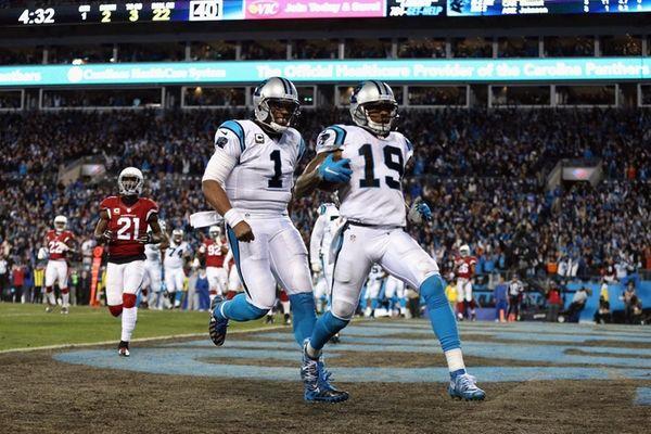 Cam Newton of the Carolina Panthers celebrates as
