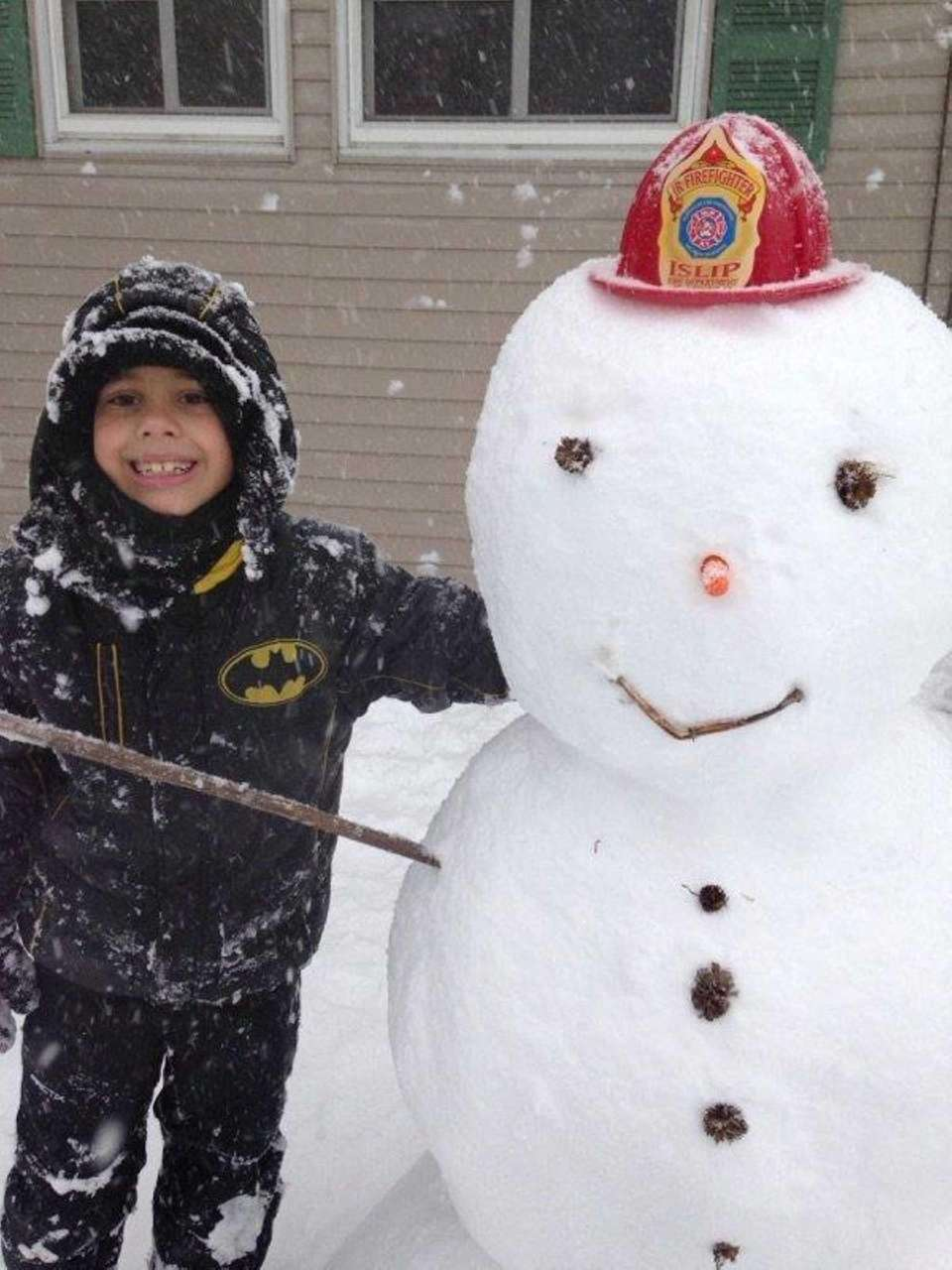 @News12LI our snowman yesterday, then today after more