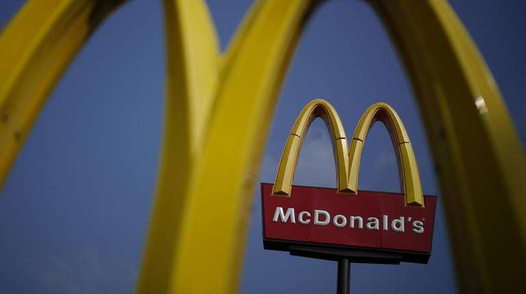McDonald's says unseasonably warm weather and serving breakfast
