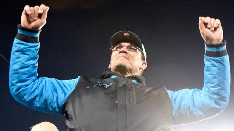 Carolina Panthers head coach Ron Rivera celebrates after
