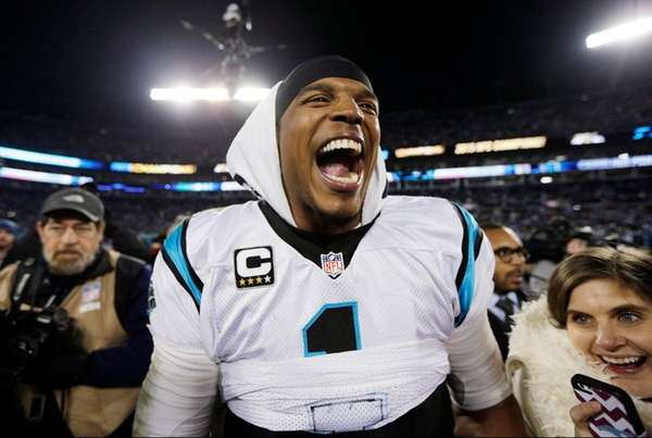 Carolina Panthers' Cam Newton celebrates after the NFC