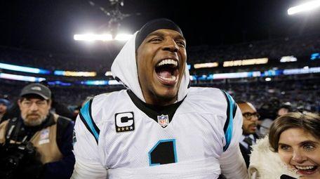Carolina Panthers' Cam Newton celebrates after the NFC