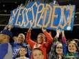 New York Mets fans hold a sign for