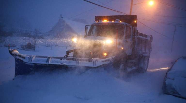 A plow clears snow on Saturday, Jan. 23,