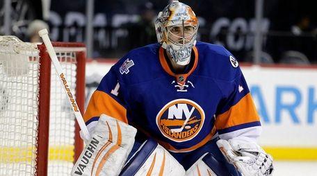 New York Islanders goalie Thomas Greiss follows the