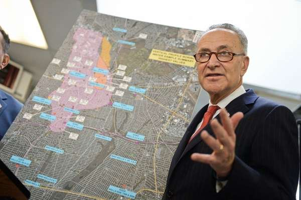 Sen. Chuck Schumer (D-N.Y.) with a map of