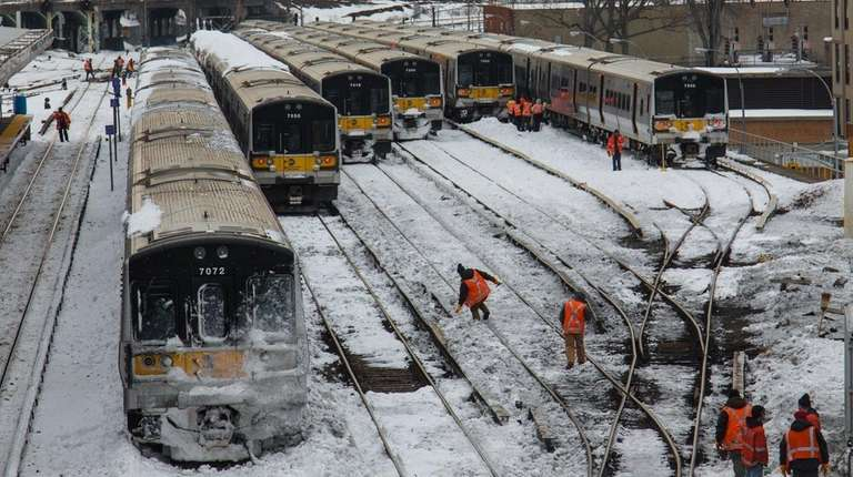 LIRR workers appear on the tracks at