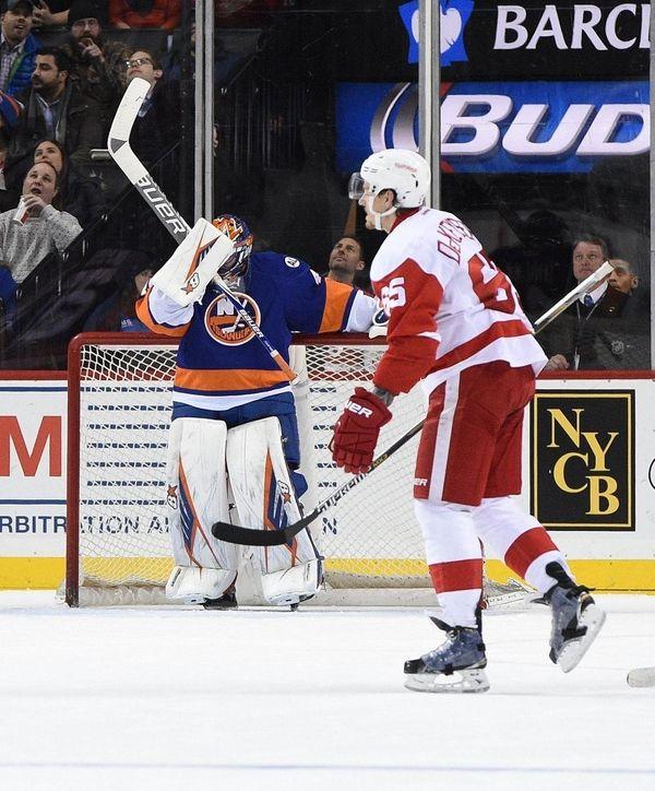 New York Islanders goalie Jaroslav Halak reacts after