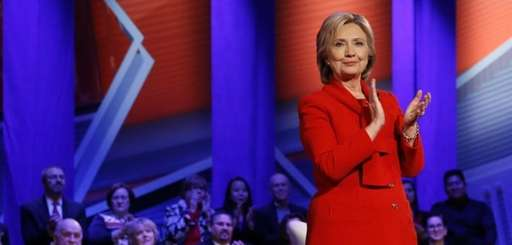 Democratic presidential candidate Hillary Clinton applauds after a