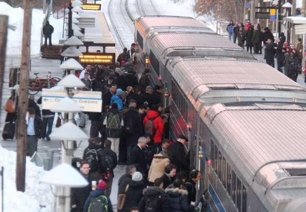 Commuters board a westbound train at the Long