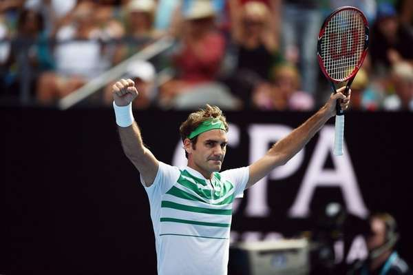 Roger Federer celebrates his win against Tomas