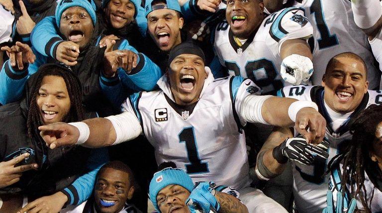 Carolina Panthers quarterback Cam Newton celebrates with