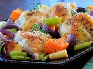 Bone-in chicken breasts are roasted with celery, butternut