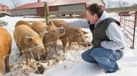Tom Geppel, co-owner of 8 Hands Farm in