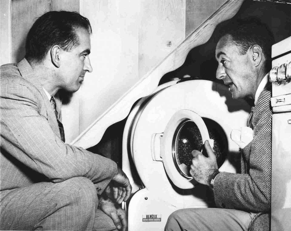 Sen. Joseph McCarthy, left, is shown the washing