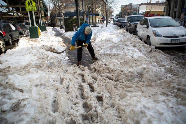 Dan Kelly, 59, volunteers to clear snow from