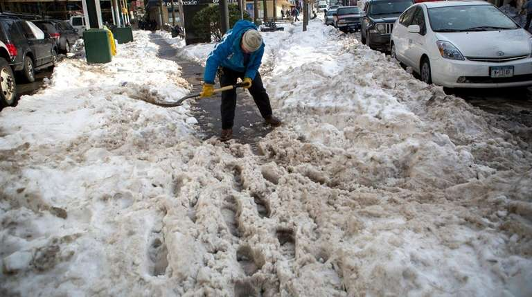 Dan Kelly, 59, volunteers to clear snow from