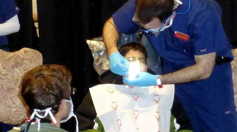 Kids can receive free dental care during the