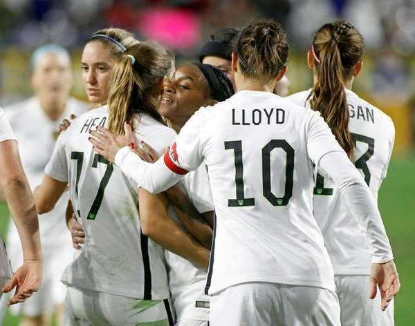United States' Crystal Dunn, center, is congratulated