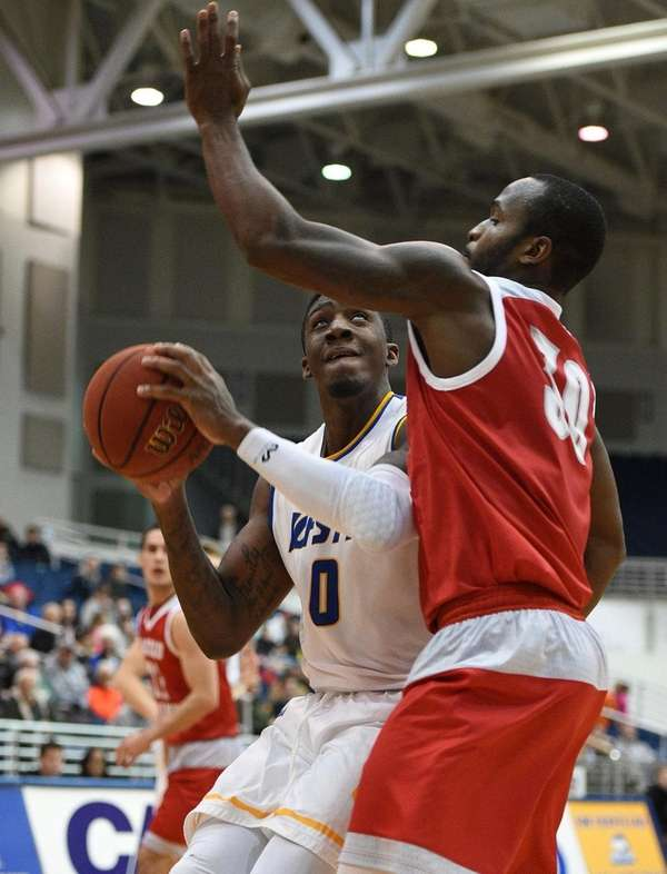 Hofstra Pride forward Malik Nichols looks for shooting