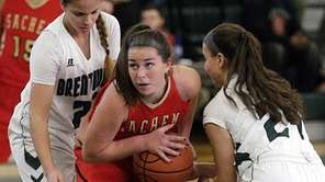 Sachem East's Kelly McKeveny (11) drives in the