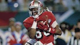 San Francisco 49ers' Jerry Rice hauls in a