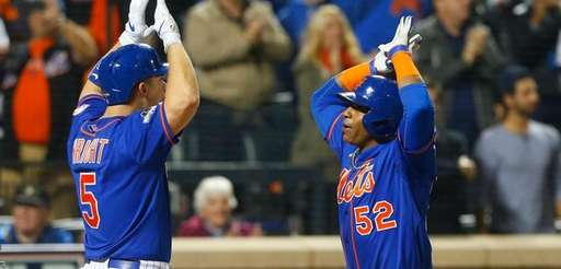 Yoenis Cespedes greets David Wright after a home