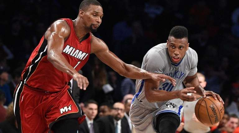 Nets forward Thaddeus Young drives against Miami Heat's