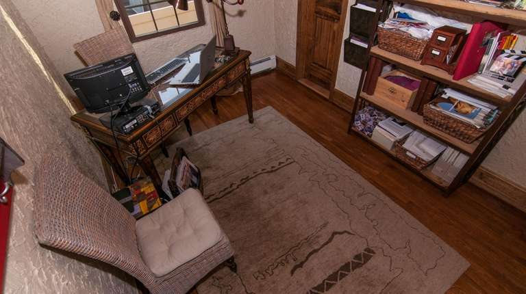A view of the office featuring Oriental rug.