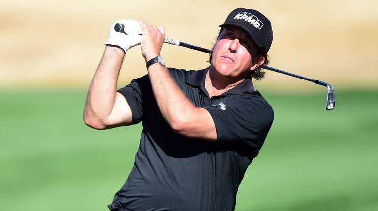 Phil Mickelson plays his second shot on