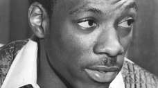 Comedian Eddie Murphy poses at his mother's home