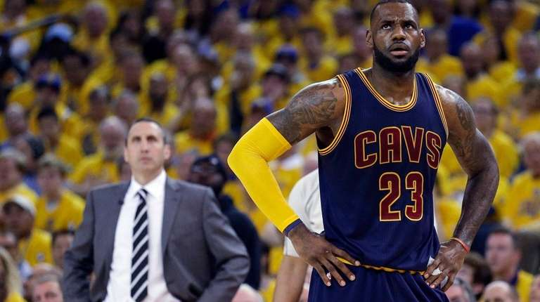 Cleveland Cavaliers forward LeBron James stands on