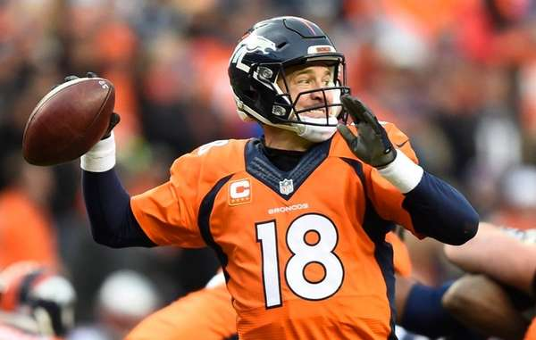 Broncos quarterback Peyton Manning passes against the Patriots