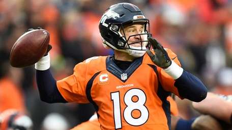 Broncos quarterback Peyton Manning passes against the Patriots
