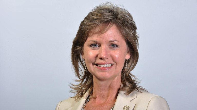 Sarah Anker, a Democratic Suffolk County legislator, poses