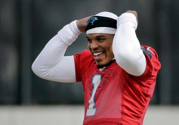 Carolina Panthers quarterback Cam Newton jokes with