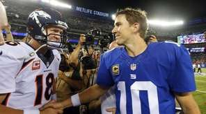 Peyton Manning, left, of the Denver Broncos shakes