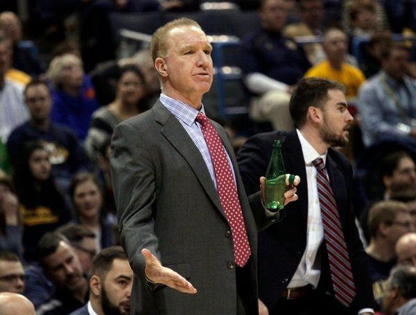 St. John's head coach Chris Mullin talks to