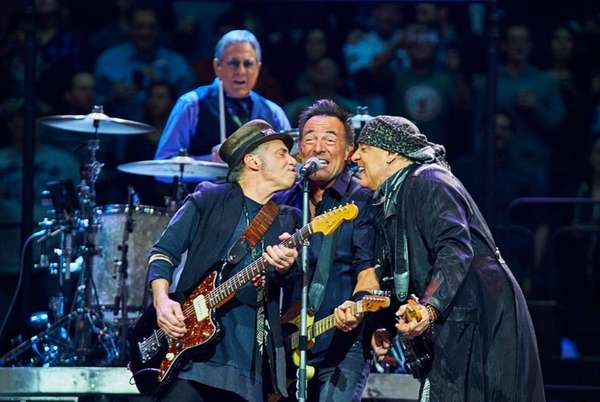 Bruce Springsteen, center, and E Street Band members