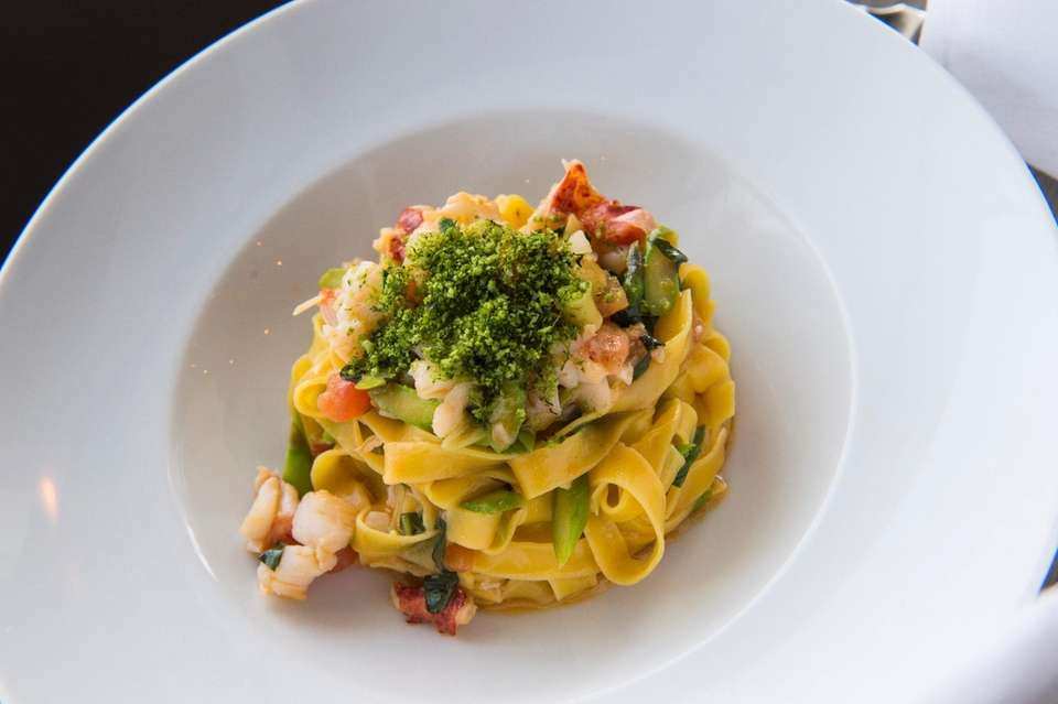 Tagliatelle with lobster is served at Scarpetta Beach