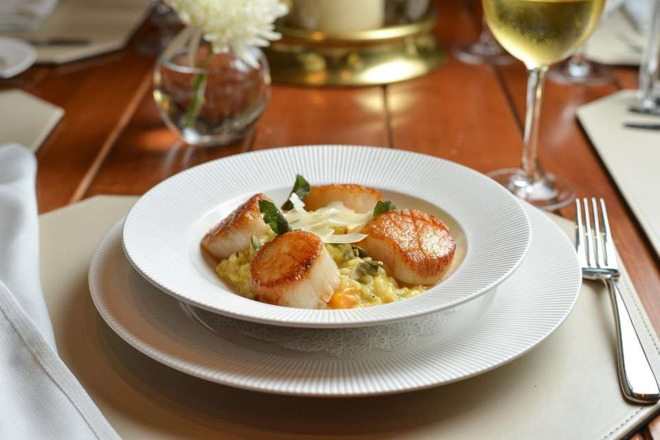 Seared Scallops with butternut squash risotto, pepitas and