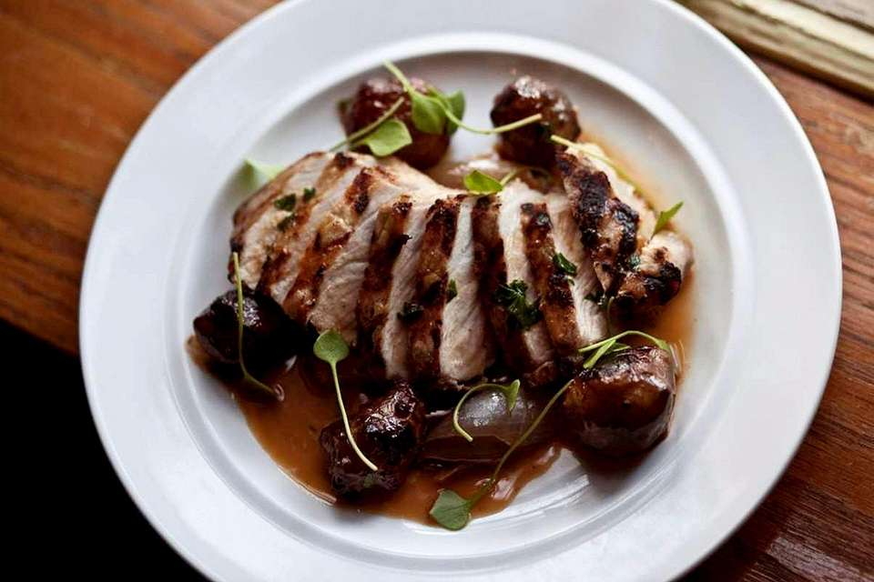 Pork with sunchokes, onions and bacon jus is