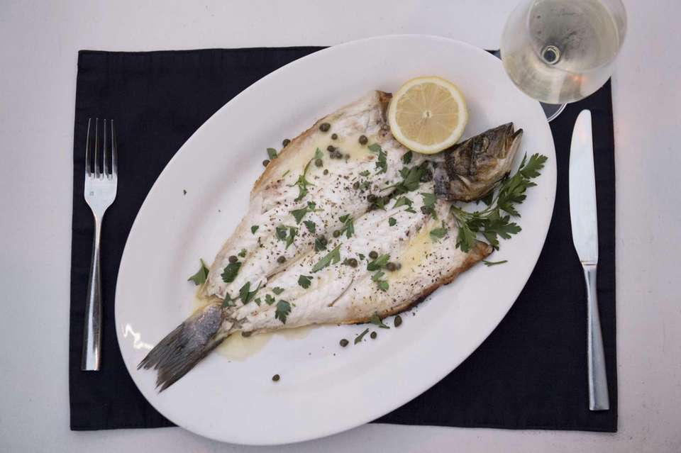 The Lavraki, or whole branzini, is a specialty