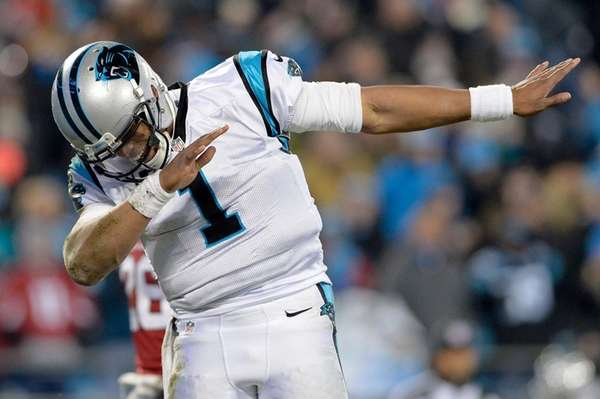 Cam Newton of the Carolina Panthers celebrates