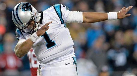 Cam Newton of the Carolina Panthers celebrates