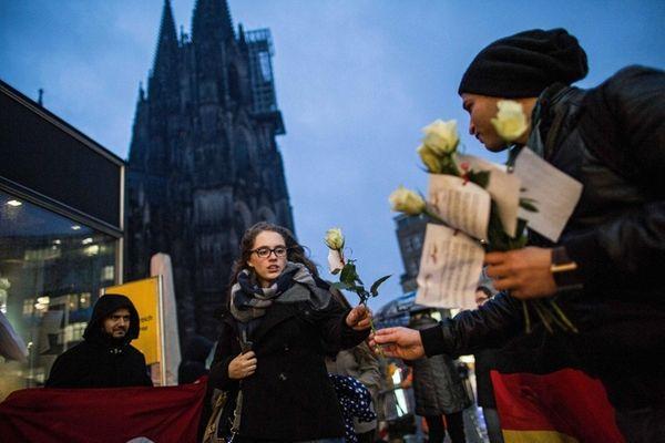 A member of a German-Tunesian association hands out