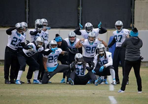 Carolina Panthers defensive backs pose for a photo