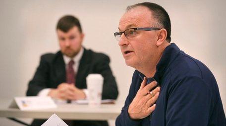 Suffolk County Legislator Robert Trotta speaks before the
