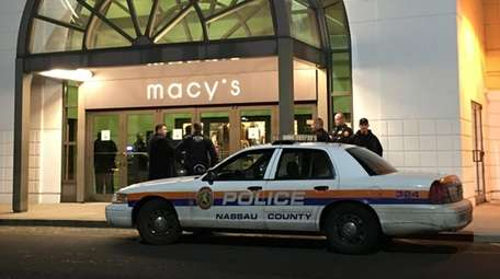 Nassau Police investigate an incident at Macy's in